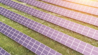Aerial Flight Over Industrial Solar Farm Panels Light Reflection Mirrors Sunrise Sunset Golden Hour Green Energy Concept