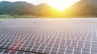 Solar Panels Farm Field Aerial Flight At Sunset Green Energy Conservation Of Power Concept Mountain Landscape