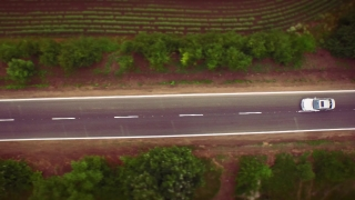 Aerial Of Car Passing By On Small Country Road Rural Countryside Nature Concept