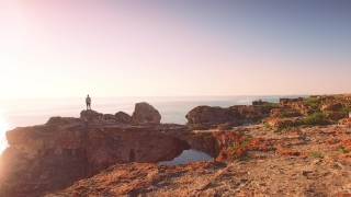 Young Man Vacation Happiness Standing On Top Of Sea Cliffs Raising Arms Joy Holiday Concept