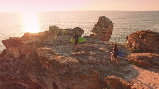 Young Couple Surfs Wetsuits Walking On Ocean  Cliff Sunset Sea Vacation Holiday  Surfers Concept
