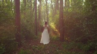 Beautiful Female Model Woman Princess Vintage Fashion Dress Walking In Mystery Forest White Bride Dress