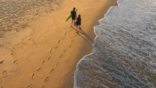 Aerial Young Surfers Walking On Sandy Beach Searching For Waves Sunset Couple Teamwork Concept