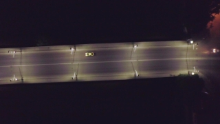 Dark Highway At Night Cars Passing Over Bridge Darkness Midnight Hour Late Urban Traffic Aerial Fly Over Street
