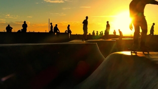 Sunset Crowd Extreme Skatepark Enjoyment Sport Skateboarding Fun Los Angeles People Youth Culture Recreation Footage Curves Sunlight Vacation Concrete