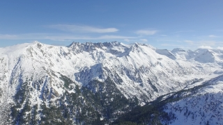 Beautiful Winter Mountain Range Aerial Flight Over Peaks Cliff Trees Nature Beauty Inspiration Background