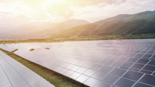 Aerial Of Solar Panel Farm Sun Energy Conservation Power Supply Sunset Green Mountains