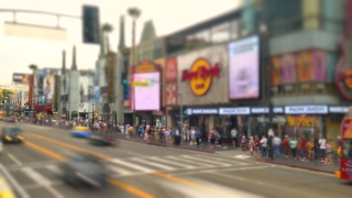 LOS ANGELES, USA - CIRCA JULY 2016: Time lapse of people walking and traffic passing on Hollywood Boulevard in front of  Hard Rock Cafe.