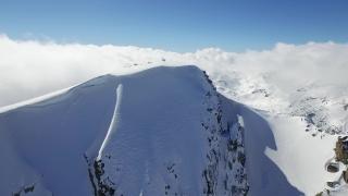 Beautiful Winter Landscape Aerial Flight Snowy Scenery Clouds Morning Mist Sun Rising Ski Vacation Concept UHD 4K