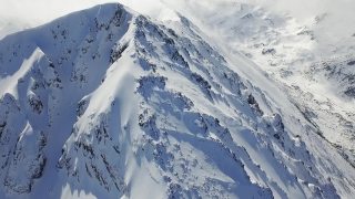 Beautiful Epic Inspiring Winter Mountain Chain Aerial Landscape Over Mountains Sunrise Morning Mist Ski Vacation Travel Extreme Sports Vacation Concept UHD 4K