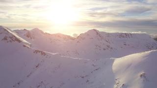 Beautiful Mountain Range Sunset Aerial Flight Epic Landscape Inspirational Worship Background Sunrise Over Mountain Peaks Winter Nature Beauty UHD 4K