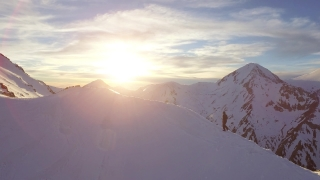 Beautiful Sunset In The Mountains Man Walking Toward Mountain Peak Success Struggle Determination Concept UHD 4K