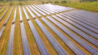 Aerial Fly Over Solar Power Panels Field Green Energy Clean Energy Production Environment Ecology Concept UHD 4K