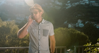 Young Businessman Tourist Man Talking  On Phone Cellphone Smartphone Travel Lifestyle Nature Countryside Mountain Sunset Light Flare Uhd 4K