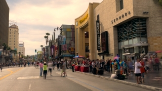 LOS ANGELES, USA - CIRCA JULY 2016: Timelapse of Hollywood Boulevard as tourists walk in front of Dolby Theatre.